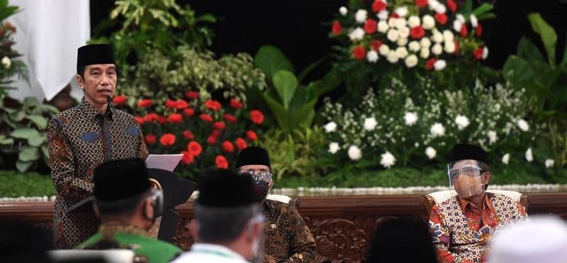 Satu Tahun Penanganan Covid-19, Sudah Saatnya Jokowi Rombak Kabinetnya