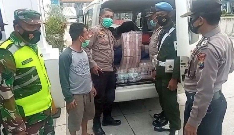 Satgas Penyekatan Temukan Uang Tunai Rp2,1 Miliar Saat Periksa Mobil di Exit Tol Ngawi