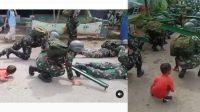 Aksi Kocak Anak Kecil ini Buat Anggota TNI yang Latihan jadi Grogi